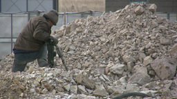 A Chinese worker is drilling concrete Stock Video Footage