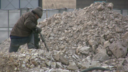 A Chinese worker is drilling concrete Footage