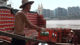 Workers loading beer onto ship in Chongqing, China Stock Video Footage