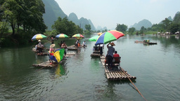 Chinese tourists on rafts in Yangshuo Stock Video Footage