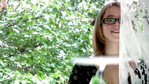 Girl washing window closeup Stock Video Footage