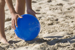 blue ball in the sand of the beach Photo