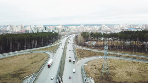 Top view of the interchange of traffic cars outside the city. Video. Traffic Live Action