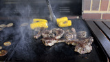 Mutton Chops and Corn Cooking on a Smokey Barbecue Footage
