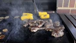 Mutton Chops and Corn Cooking on a Smokey Barbecue Stock Video Footage