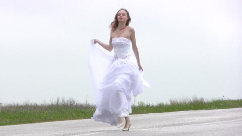 Bride comes on the road Stock Video Footage