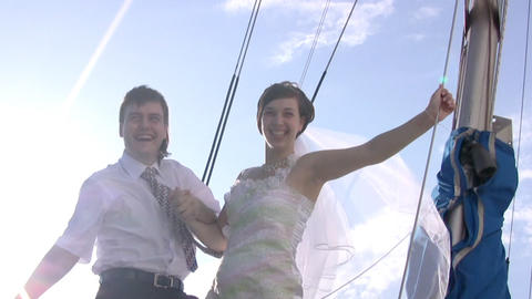 Groom, bride, yacht and sun Stock Video Footage