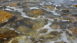Wave Washing onto Rocks in the Sea Stock Video Footage