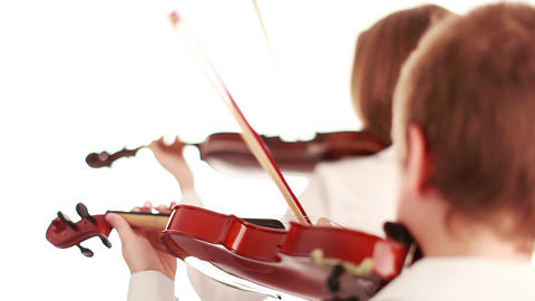Two teenager playing the violin, studio shot Stock Video Footage