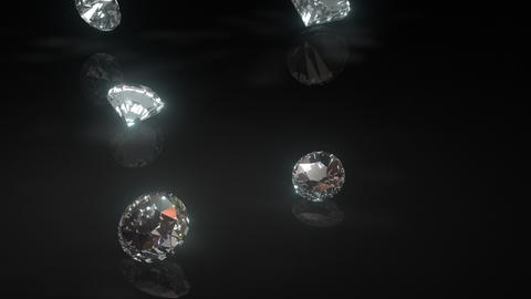 Diamonds Drop onto Shiny Black Surface Loop Stock Video Footage