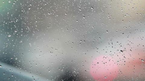 Rain Drops Against Traffic Footage