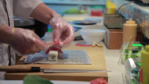 Cooking Of Salmon Sushi Roll Stock Video Footage