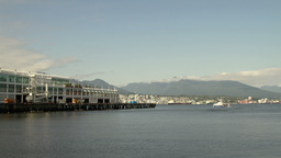 Sea Bus moving away by Canada Place, Vancouver Stock Video Footage