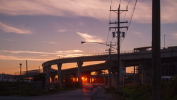 Time Lapse of Sunset by the Skytrain bridges in Ri Stock Video Footage