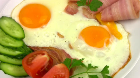 Plate with fried eggs. Close-up Footage
