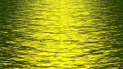 shine golden light reflecting on ocean Stock Video Footage