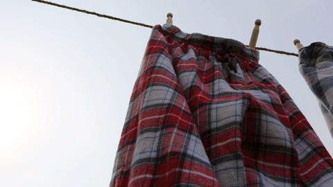Red Pyjamas Drying HD Stock Video Footage