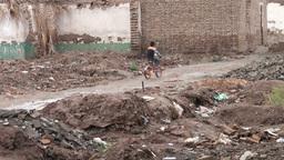 Boy cycles through demolished Kashgar old town Stock Video Footage