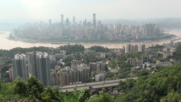 Chongqing skyline is visible behind trees Stock Video Footage