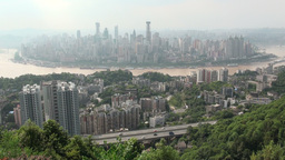 Chongqing skyline is visible behind trees Footage