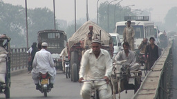 Diverse traffic on old Lahore bridge Stock Video Footage