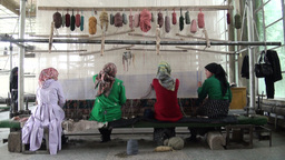 Girls discussing carpet work in Chinese factory Footage