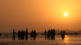 Group of people at Karachi beach at sunset Stock Video Footage