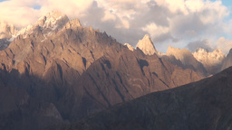 Last sunlight disappears over rugged mountains in  Footage