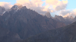 Last sunlight disappears over rugged mountains in Stock Video Footage