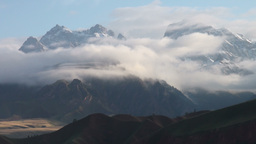 Mist rolls in on Tibetan mountains Stock Video Footage