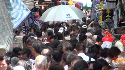 Person holds umbrella high at busy Kowloon market, Stock Video Footage