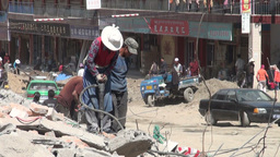 Tibetan woman works on a Chinese construction site Stock Video Footage