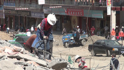 Tibetan woman works on a Chinese construction site Footage