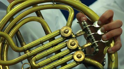 Hands play wind instrument 1 Stock Video Footage