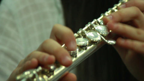 Hands play wind instrument 3 Stock Video Footage