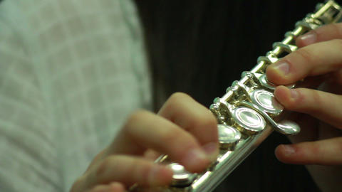 Hands play wind instrument 3 Footage