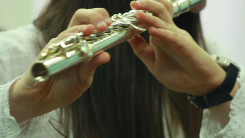 Hands play wind instrument 5 Stock Video Footage