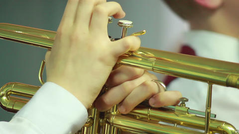 Hands play wind instrument 7 Footage