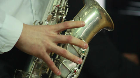 Hands play wind instrument 9 Stock Video Footage