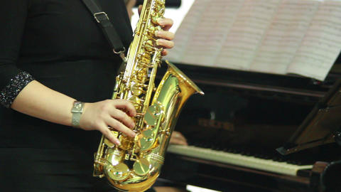 Hands play wind instrument 13 Stock Video Footage