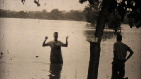 Two Men Check Out Their Flooded Backyard In Dallas 1948 Vintage 8mm Footage
