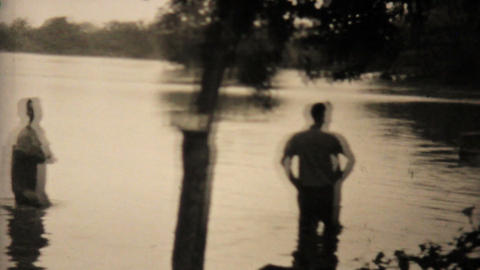 Two Men Check Out Their Flooded Backyard In Dallas 1948... Stock Video Footage