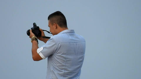 Male Photographer Taking Photo Footage