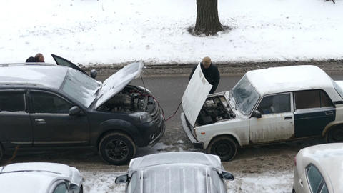 Help With The Battery in The Car in Moscow Winter Live Action