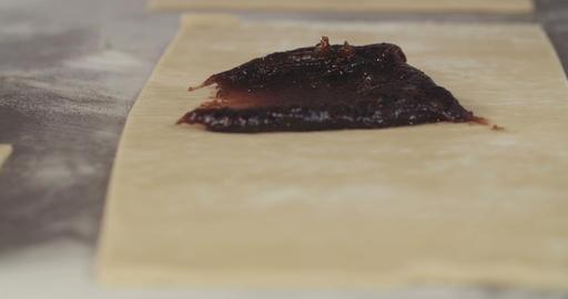 Baker preparing prune filled strudel Footage