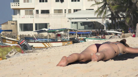 Woman Sunbathing On Beach Footage