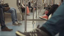 People sitting inside a underground metro car Footage