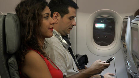 Board Airline Passengers On Airplane Footage
