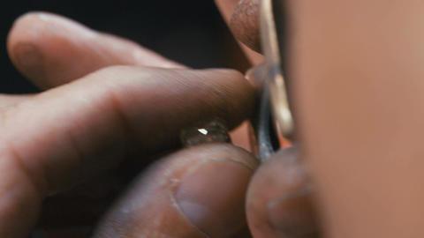 Gemologist inspecting a large diamond in a diamond… Stock Video Footage