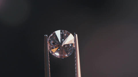 Gemologist inspecting a large diamond in a diamond processing workshop Footage